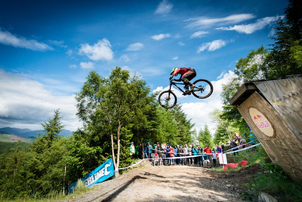 Mountain Biker doing a stunt against a beautiful blue sky