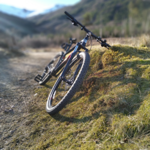 A Mountain Bike with hills as a back drop
