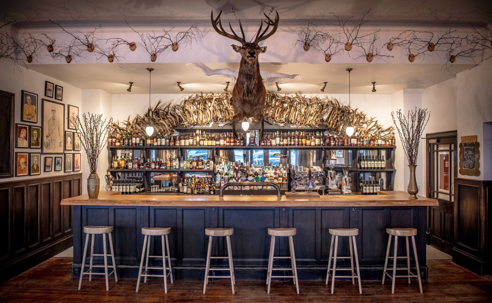Scottish wooden bar, with bar stools and Stags head, in Ginspired Scotland day trip to Royal Deeside.