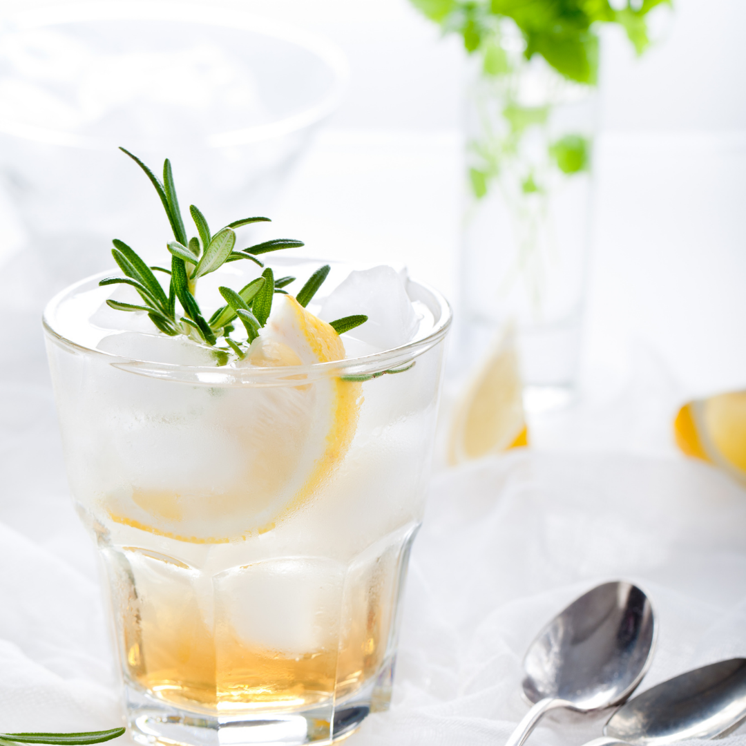 Gin & Tonic with Ice and lemon and a sprig of rosemary